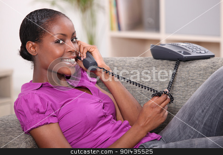 Teenage girl at home on the telephone stock photo, Teenage girl at home on the telephone by photography33