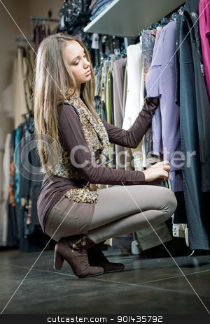 Shopping spree. stock photo, Beautiful young brunette woman on a shopping spree showing off new clothes. by exvivo