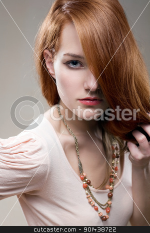 Artistic portrait of gorgeous young redhead. stock photo, Artistic portrait of gorgeous young redhead with intense look on her face. by exvivo