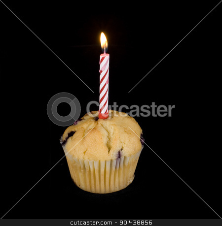 first birthday cake stock photo, cupcake with a single lit candle on top by Stephen Gibson
