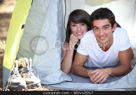 Teenage couple in a tent stock photo, Teenage couple in a tent by photography33