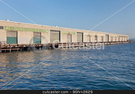 industrial pier stock photo, industrial pier in San Francisco waterfront with storage gates by Marek Uliasz