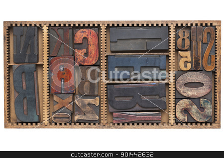 antique letters and numbers stock photo, letters and numbers - a variety of vintage letterpress printing blocks  in a small wooden typesetter box with dividers, isolated on white by Marek Uliasz