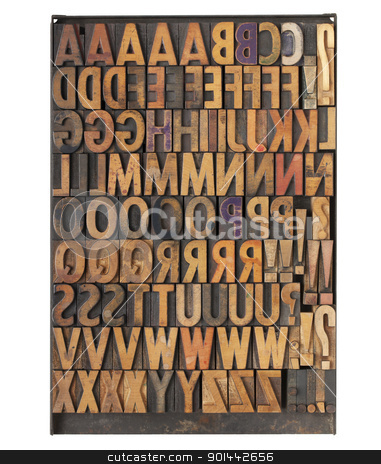 vintage letterpress printing blocks stock photo, vintage wood letterpress printing blocks on a metal tray - the entire English alphabet with duplicate symbols and punctuation by Marek Uliasz