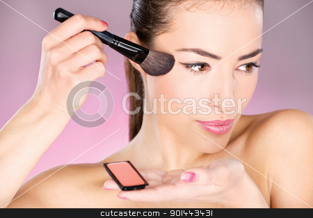 woman applying cosmetic powder brush stock photo, pretty woman applying cosmetic powder brush by iMarin