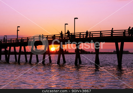 Fishing at Sunset stock photo, Fishing off the pier at sunset,Sarasota,Florida,USA by Delmas Lehman