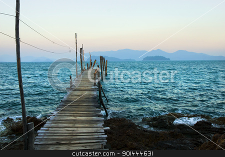 Gulf of Thailand Scenery stock photo, The Gulf of Thailand at dusk, wooden pier on turquoise water and islands on the horizon by Rognar