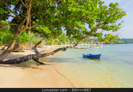 Tropical Island Scenery stock photo, Scenic remote white sand beach on the tropical island in Thailand, small boat and swing attached to a tree by Rognar