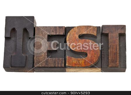 test word in letterpress type stock photo, test - isolated word in vintage wood letterpress type, stained by color inks by Marek Uliasz