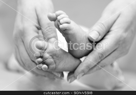 Mother gentle touch - cute baby feet stock photo, Mother's gentle ...