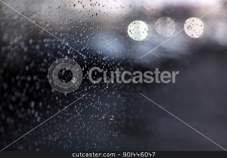drops of rain on window stock photo, raindrops and light on window by anton havelaar