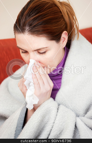 woman sneezing in the handkerchief stock photo, Young woman sneezing in the handkerchief by iMarin