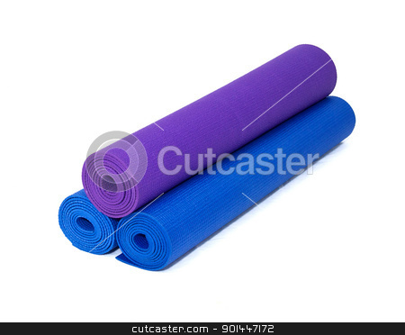 three rolled yoga exercise mats stacked on white stock photo, three rolled yoga exercise mats against white. by Stephen Orsillo