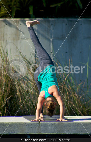 woman doing yoga outdoors in three leg down dog pose stock photo, an athletic brown haired woman is doing yoga exercise three leg downward facing dog pose outside in park in direct sunlight. by Stephen Orsillo