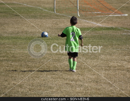 Youth Soccer football players stock photo, Youth soccer game with green grass. low shots with unreconizable faces. by Jeremy Baumann
