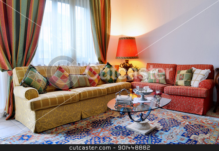 Classic living room stock photo, Elegant living room with classic looking sofa, colorful curtains, lamp and glass table by Stefano Cavoretto
