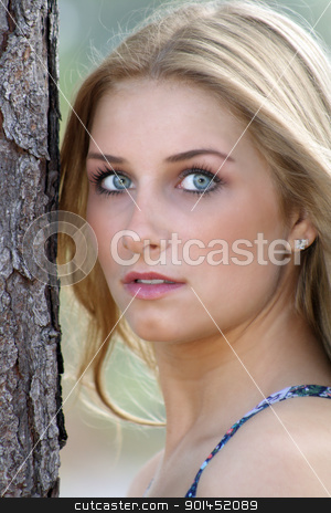Beautiful Young Blonde Outdoors (2) stock photo, A close-up of a lovely young blonde with captivating eyes outdoors. by Carl Stewart