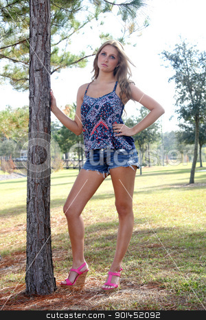 Beautiful Young Blonde Outdoors (5) stock photo, A lovely, young blonde with long, beautiful legs outdoors. by Carl Stewart