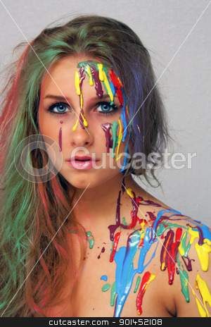 Beautiful Young Blonde, Headshot (6) stock photo, A studio close-up of a lovely young blonde with multicolored hair and several colors of paint poured and dripping on her. by Carl Stewart