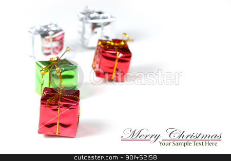Tiny christmas gifts stock photo, Tiny christmas gift boxes against white background by Sreedhar Yedlapati