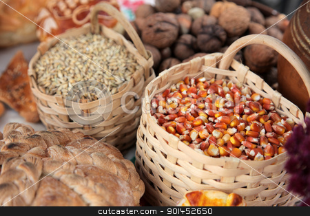 Basket with wheat and maize stock photo, Basket with wheat and maize by Zvonimir Atletic