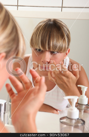 portrait of a woman applying make-up stock photo, portrait of a woman applying make-up by photography33