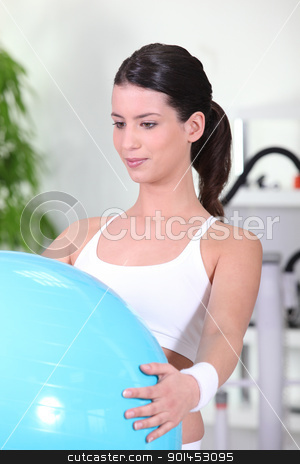 young woman doing Swiss ball exercises stock photo, young woman doing Swiss ball exercises by photography33