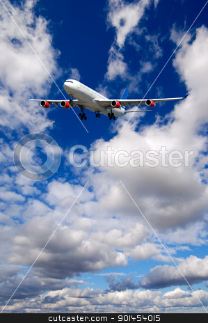 Air travel - Plane is flying in blue sky with clouds stock photo, Air travel - Plane is flying in blue sky with clouds by Lars Christensen
