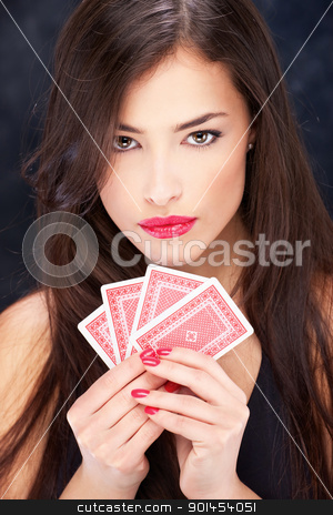 Pretty woman holding cards stock photo, Pretty long hair woman holding cards by iMarin