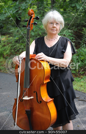 Female cellist. stock photo, Female cellist standing with her cello. by OSCAR Williams