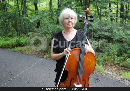 Female cellist. stock photo, Female cellist standing with her instrument outside. by OSCAR Williams
