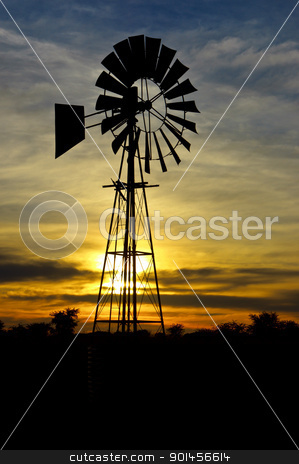 Wind Pump stock photo, Wind Pump at sunrise with clouds by Riaan Roux