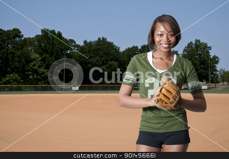 Baseball Player stock photo, Black African American woman playing baseball at a community park by Robert Byron