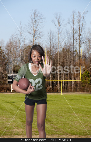 Black Woman Football Player stock photo, Beautiful black African American woman playing football by Robert Byron