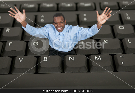 Man Using Computer stock photo, A black African American man computer user by Robert Byron