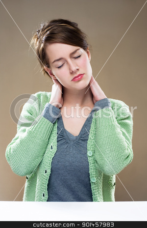 Wasted... stock photo, Gorgeous young brunette woman showing symptoms of neck pain. by exvivo