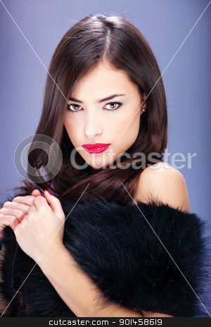 pretty woman with long hair stock photo, Portrait of a pretty woman with pelt by iMarin