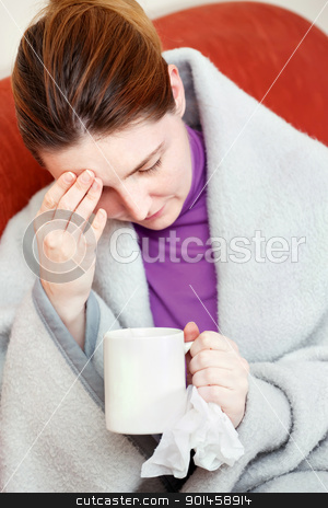 sick woman having headache stock photo, A young sick woman having headache, holding cup of tea and handkerchief by iMarin