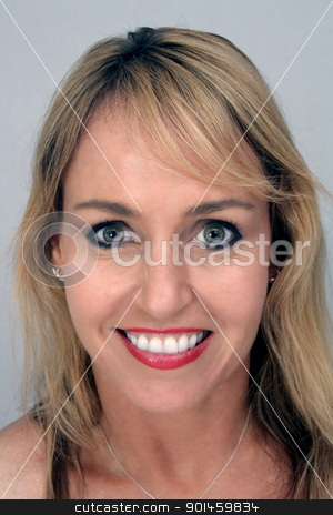 Beautiful Blonde Headshot (1) stock photo, Studio close-up of a lovely blonde with a captivating smile. by Carl Stewart
