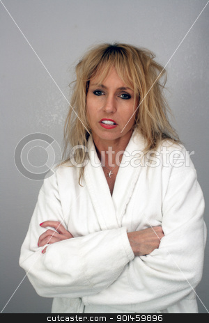 Beautiful Irritated Blonde stock photo, A lovely blonde with frizzed hair and an irritated facial expression. by Carl Stewart