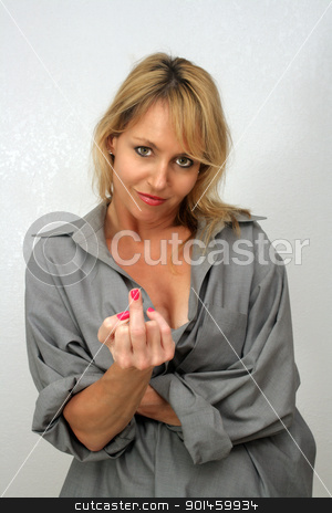 Beautiful Blonde Gives You the Finger stock photo, A lovely blonde gives you the middle finger. by Carl Stewart