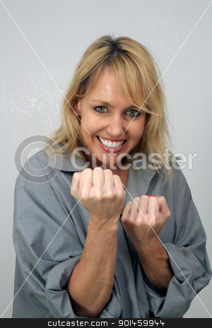 Beautiful Blonde Playfully Raises Her Fists stock photo, A lovely blonde with a captivating smile raises her fists to play-fight. by Carl Stewart