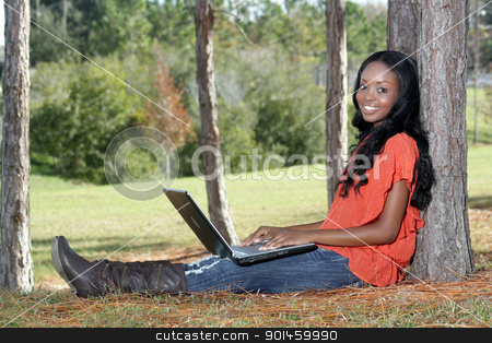 Beautiful Casual Woman Outdoors with Laptop (2) stock photo, An extraordinarily beautiful young woman with a captivating smile, dressed in casual wear, works on her laptop computer outdoors. by Carl Stewart