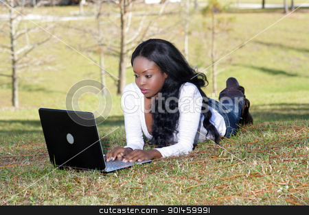 Beautiful Casual Woman Outdoors with Laptop (3) stock photo, An extraordinarily beautiful young woman dressed in casual wear, works on her laptop computer outdoors. by Carl Stewart