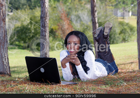Beautiful Casual Woman Outdoors with Laptop (8) stock photo, An extraordinarily beautiful young woman with a captivating smile, dressed in casual wear, works on her laptop computer outdoors.  Generous copyspace. by Carl Stewart