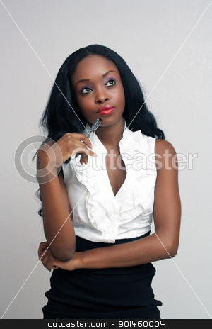 Beautiful Young Businesswoman (4) stock photo, An extraordinarily beautiful, contemplative, young businesswoman holding an ink pen. by Carl Stewart