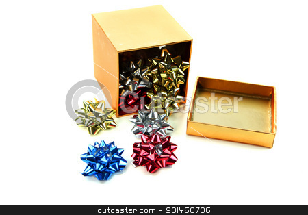 Box of bows stock photo, Box of small bows on white background by Sreedhar Yedlapati