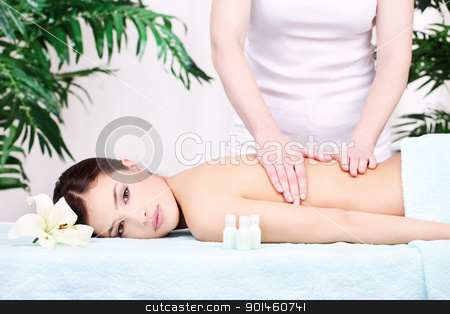 woman on back massage stock photo, Pretty woman on back massage in spa center by iMarin