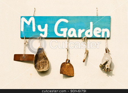 Old gardening tools as decoration stock photo, Old gardening tools as decoration hang on white wall. by Lawren