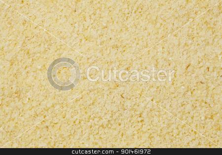 semolina flour at life-size stock photo, background of yellow semolina wheat flour at life-size magnification by Marek Uliasz